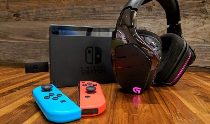 Nintendo Switch with the Logitech G933 wireless headset connected via USB.