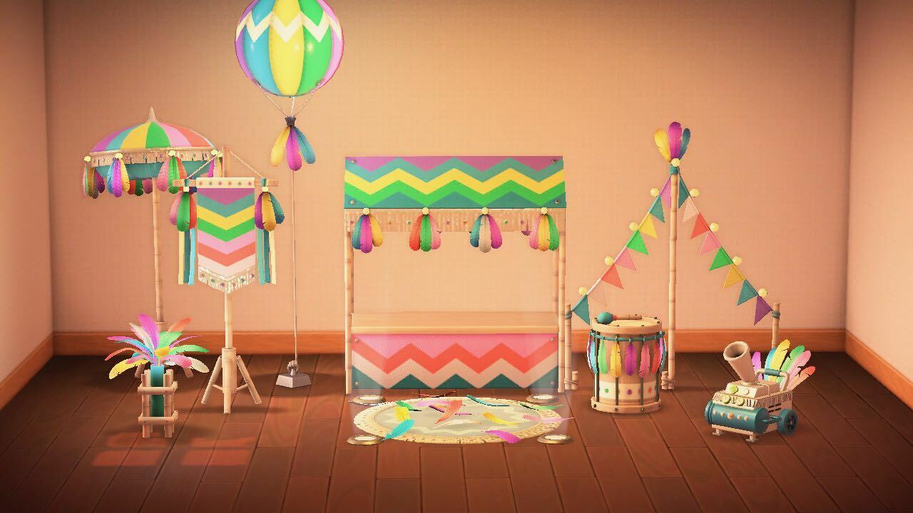The Festivale set in the rainbow color variant. From left to right, back to front: parasol, lamp, flag, balloon lamp, stall, stage, garland, drum, and confetti machine. You can see the other color variants in the gallery below.