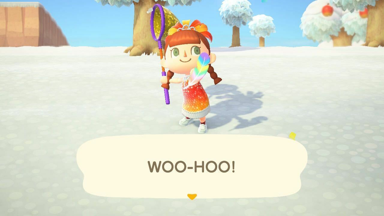 Catching a rainbow feather in Animal Crossing: New Horizons.