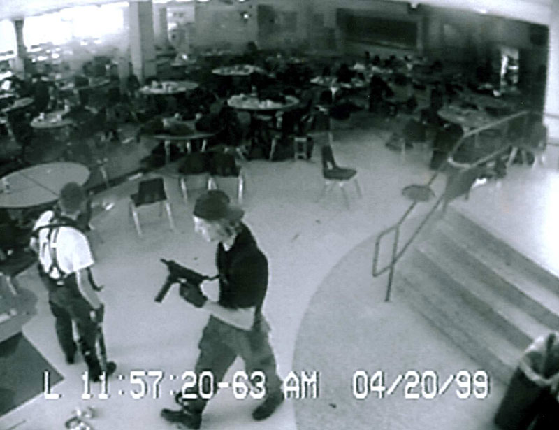 A chilling security camera still of Harris and Klebold on that tragic day.