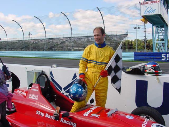 Dave Kaemmer at Watkins Glen with the checkered flag.