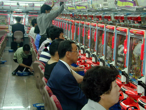 Go to Japan and you'll find parlors full of people playing Pachinko.