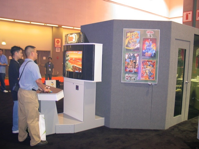 Fans playing the now-canceled PS2 version of Metal Slug 3 in SNK's booth at E3 2003.