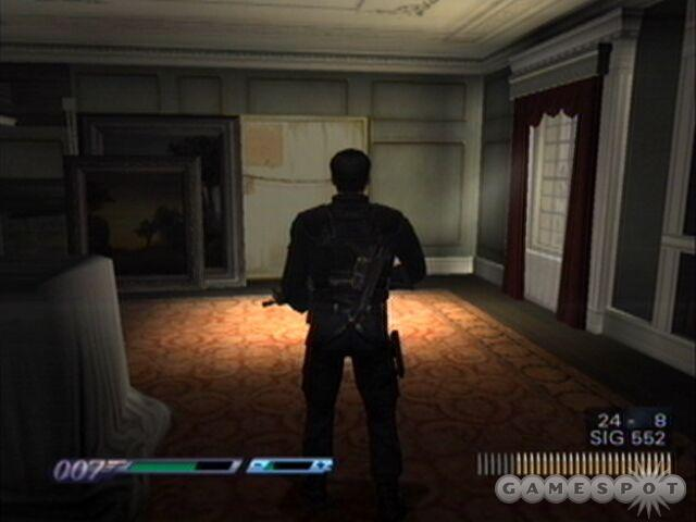 Just behind the picture is the entrance to the hidden weapons cache, and the switch that opens it is to the left of it.