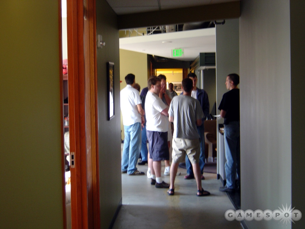 The Valve team prepares for the daily status update meeting.