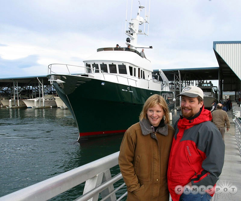 Mike and Monica Harrington in front of their boat.
