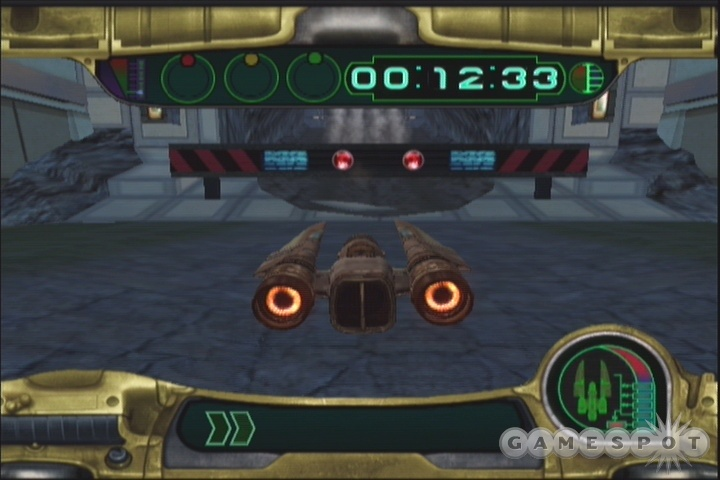 Some of the new Swoop tracks in KOTOR2 feature obstacles like this barrier; hit the B button to jump over them.