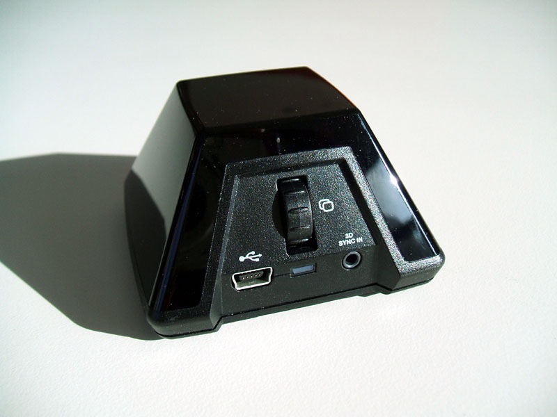 The infrared emitter can synchronize with multiple glasses, so several people can watch the same display.