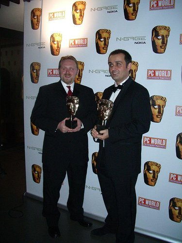 Christian Allen (l.) shows off his BAFTA award.