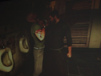 Splinter Cell: Conviction will feature an interrogation minigame that lets players use the environment. Unfortunately for this goon, the environment is a filthy men's room.
