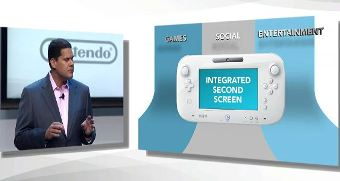 Reggie onstage talking up the Wii U.