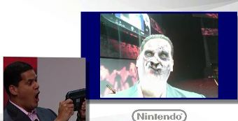 Reggie getting zombie-fied at the Nintendo briefing.