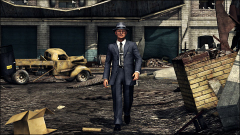 Walking through the rubble of a burned-down building in L.A. Noire's new DLC.
