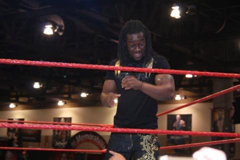 Kofi Kingston sharing a moment with a ringside fan.