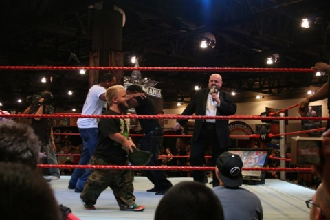 Hornswoggle and Howard Finkel work the ring while Cryme Tyme celebrate JTG's win.