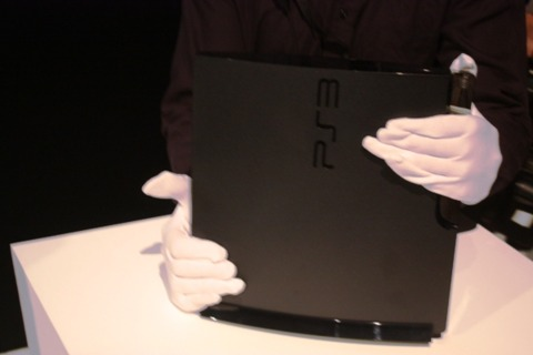 The new PS3 Slim being whisked away by white-gloved security.