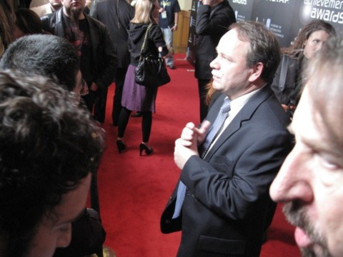 Sid Meier walks the red carpet before the Achievement Awards.