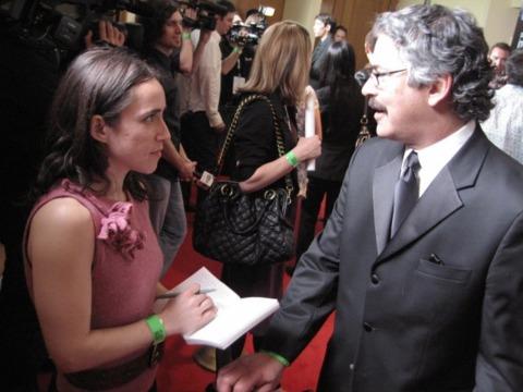 Journalist Heather Chaplin interviews AIAS president Joseph Olin on the red carpet.