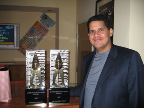 Nintendo's Reggie Fils-Aime stands guard over the Lifetime Achievement Awards handed out earlier in the night to Minoru Arakawa and Howard Lincoln.