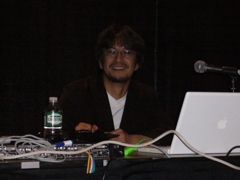 Eiji Aonuma poses for photos before his talk.