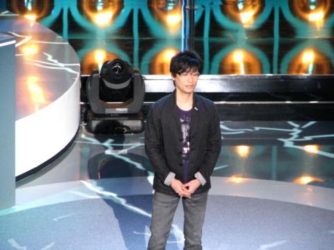 Kojima on stage.