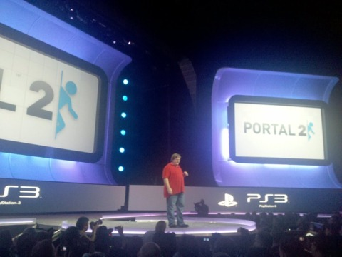Gabe Newell on stage praising the PlayStation 3 while announcing Portal 2 for the PS3.