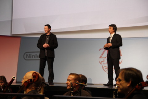 Miyamoto in front of the orchestra.
