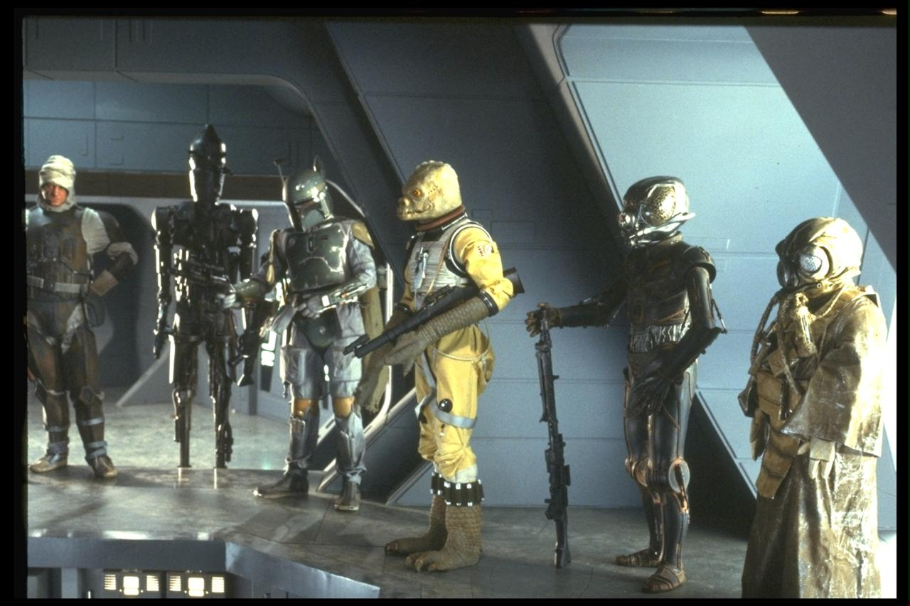 Which bounty hunter in The Empire Strikes Back is wearing an old costume from a Doctor Who episode?