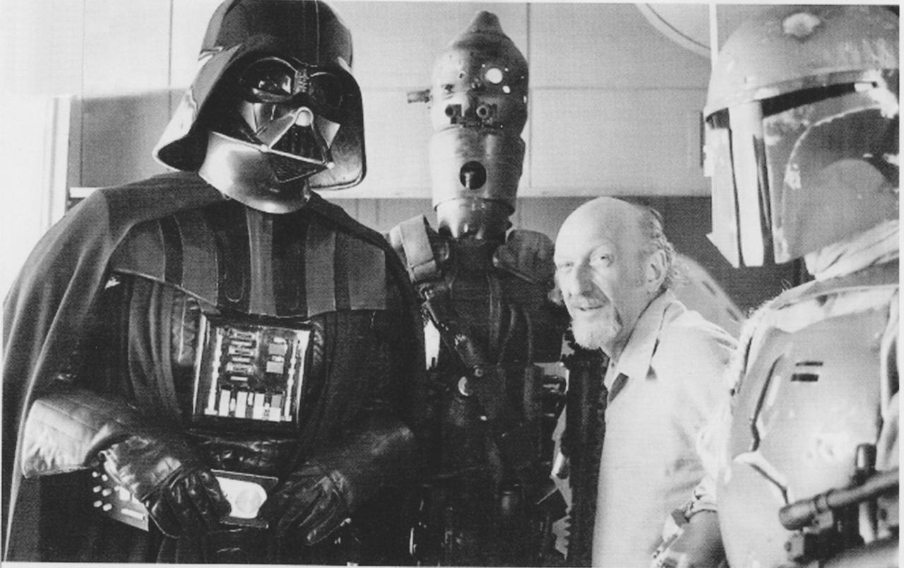 Darth Vader's chestpiece has some writing on it. What language is it in, and what does it translate to?
