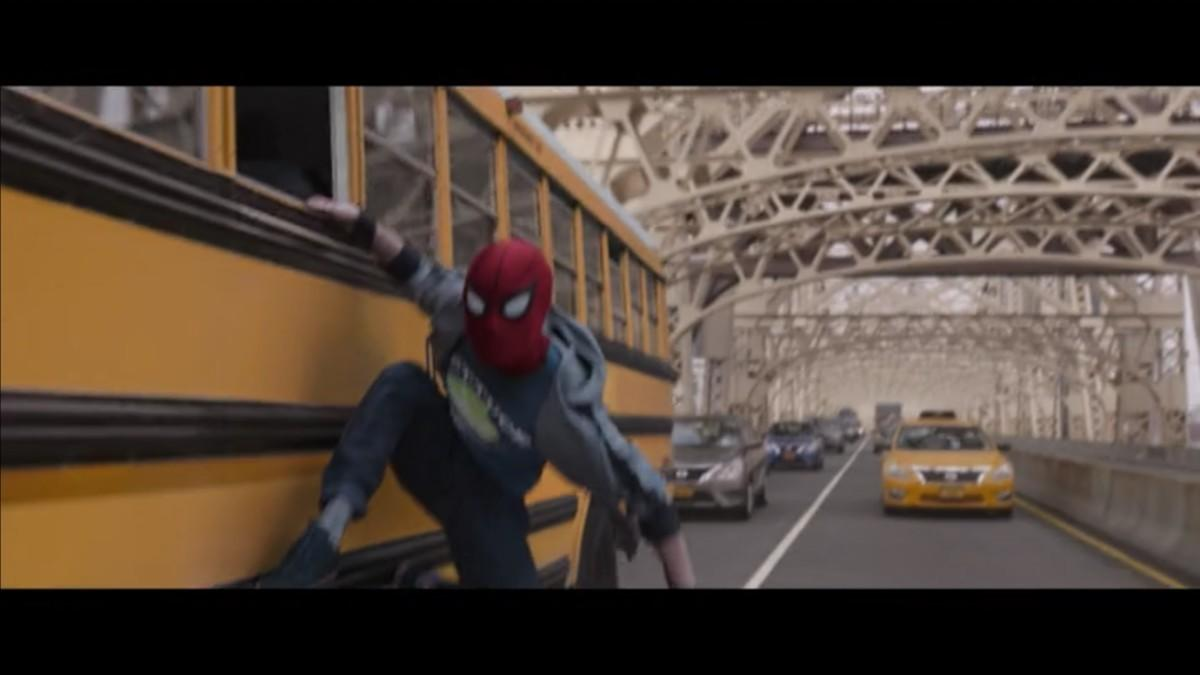7. Peter Parker sticking to the side of a school bus on a bridge isn't very covert.