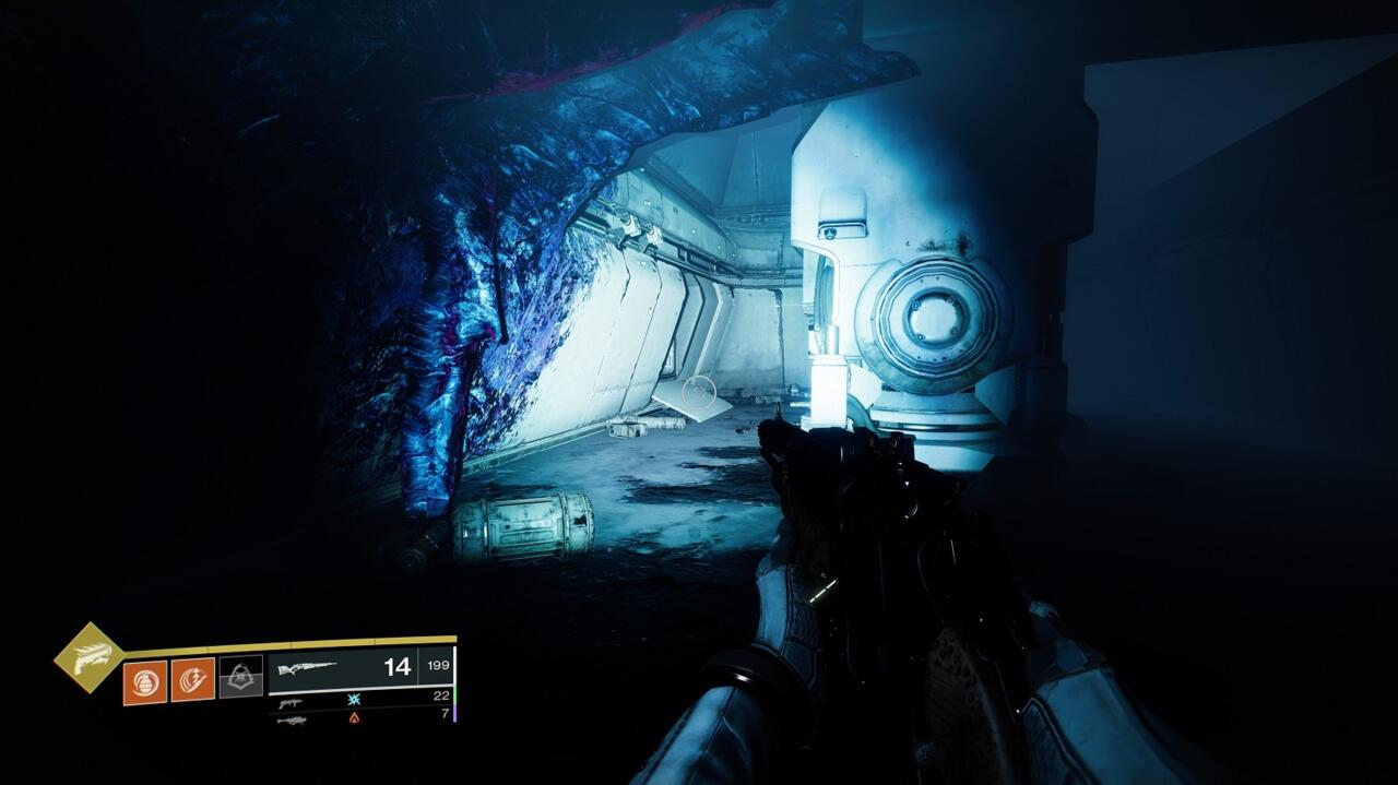 Pass through the Turbine Room, which has the electrified barrier and spinning, grinder-like floor. The cache is in the dark, fungus-infested room after you first jump across the gap, before you reach the second gap.
