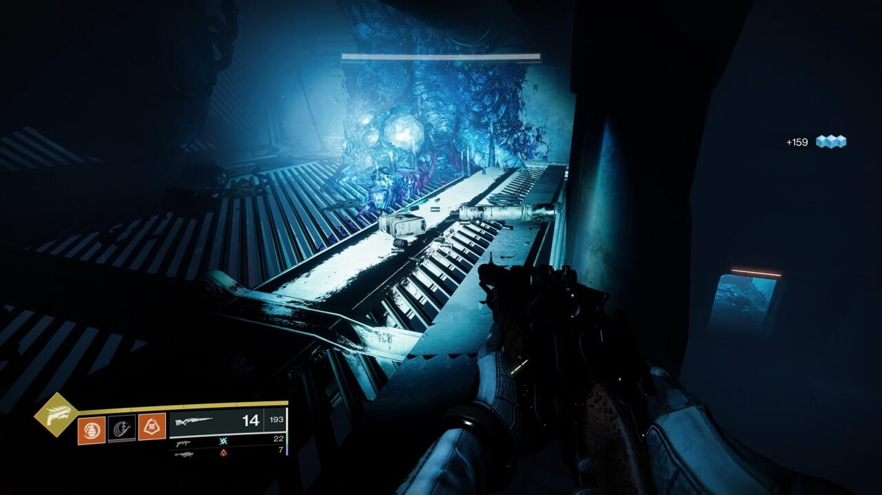 Jump up to the floor above the cache and use the spores you find there to pass through the barrier below.
