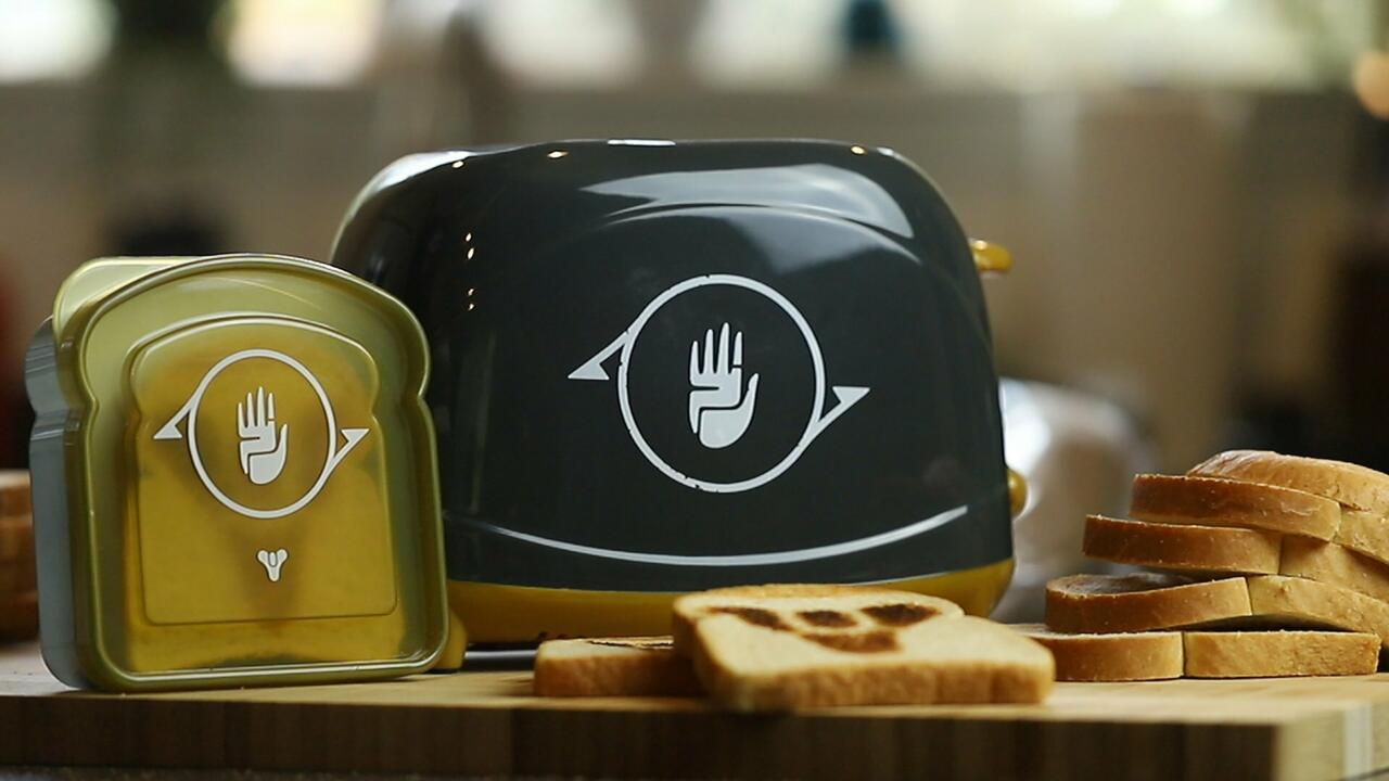 Destiny 2's Jotunn-themed toaster bears its color scheme and Black Armory logo, and also comes with a convenient plastic case for exactly one sandwich.