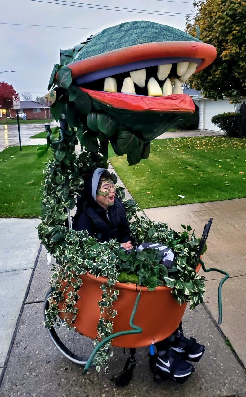 Honorary mention of this costume submitted by Lonnie S. of her son Daniel. They incorporated his wheel chair on his costume of Audrey 2 from the Little Shop of Horrors.