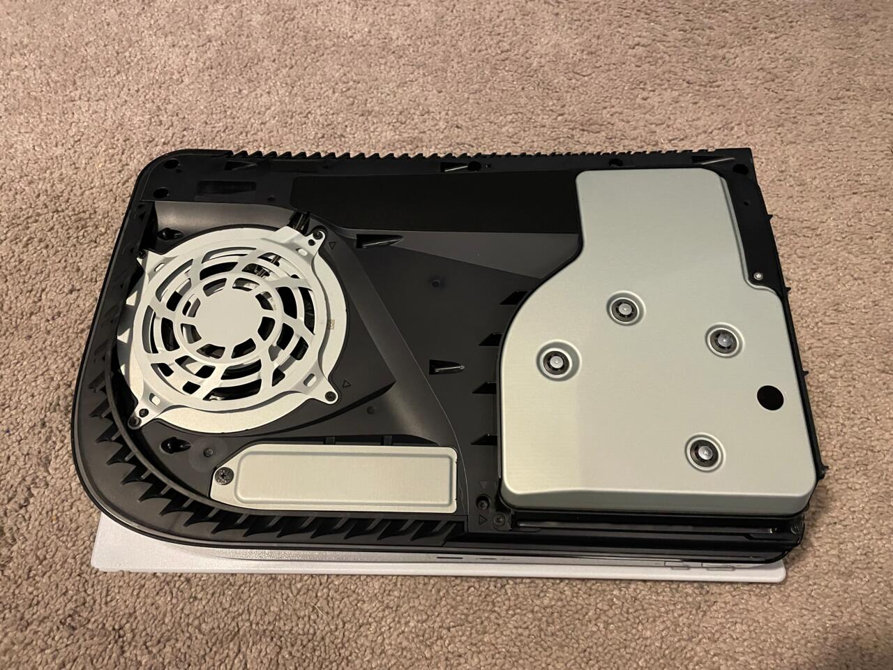 Bottom of the PS5 with the panel off